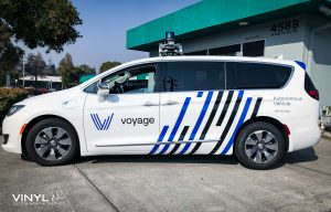Custom Graphic Decals Installed to both sides of Voyage's Autonomous Van
