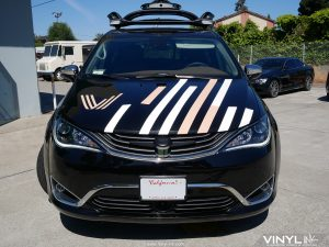 Custom Graphic Decals Installed to the hood of Voyage's Autonomous Van