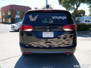 Custom Graphic Decals Installed to the rear of Voyage's Autonomous Van