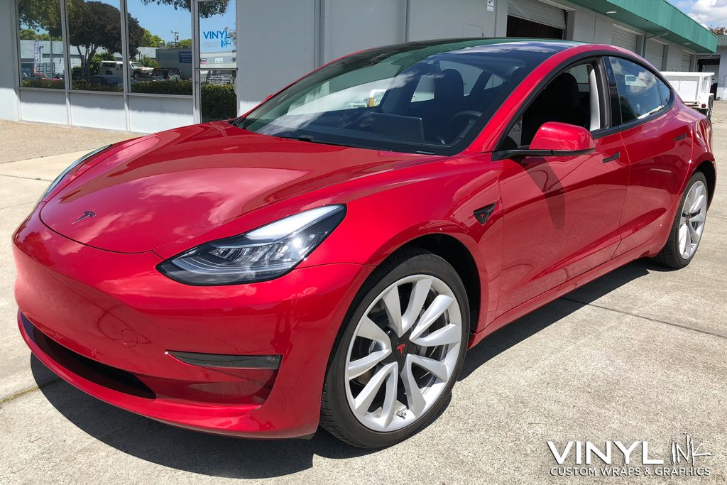 Full Satin Black Blackout Delete of Chrome on a Red Tesla Model 3